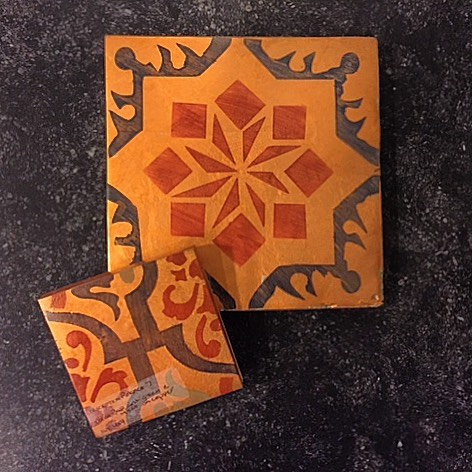 Delivering samples! Custom made for a client by @tabarkastudio. Here we have the Maghreb 5 and Polanco 7 patterns, both with a hand-applied Metallic Copper background.  One of the things we love about tile - it can be customized to fit your design vision, which is anything but cookie cutter! #handmade #handpainted #terracotta#tiles