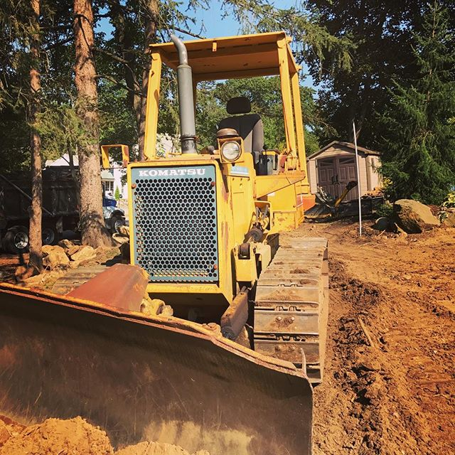 Vehicle of change. #newenglandlandscaping #dozer #backyardproject #oakwoodslandscaping #makeitbeautiful #makeituseful