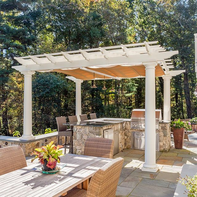 Adding entertaining space to your yard adds life (and often value) to your property! We can help you create something special. 🍁🥂 (📸 by @bdw_photography bdw_photography) #newenglandlandscaping #makeitbeautiful #pergola #bluestone #frontgate #outdoorkitchen #oakwoodslandscaping