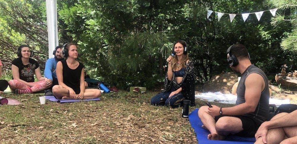 Leading a meditation at Elementum Festival, 2018.