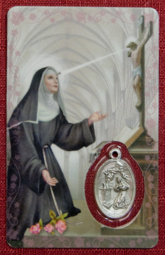 - Prayer Card with Medal $3                                                           This prayer card contains a Saint Rita medal, image and prayer; the card is fully laminated.