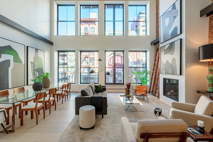 41 GREAT JONES STREET, DUPLEX - $15,000,000 | 3 BED | 3 BATH | 4,235 SQFTBlending contemporary lines with traditional urban charm, this stunning 3-bedroom, 3.5-bathroom duplex condo unfurls a bespoke collection of high-end finishes across a thoughtful, open plan layout. Features of this 4,235 sq. ft. home include 10-inch wide European oak floors, a soaring 21-ft double-height ceiling in the living area, exposed brick detailing, a pair of private balconies, a home office, an in-home washer/dryer, and a private keyed elevator entrance.