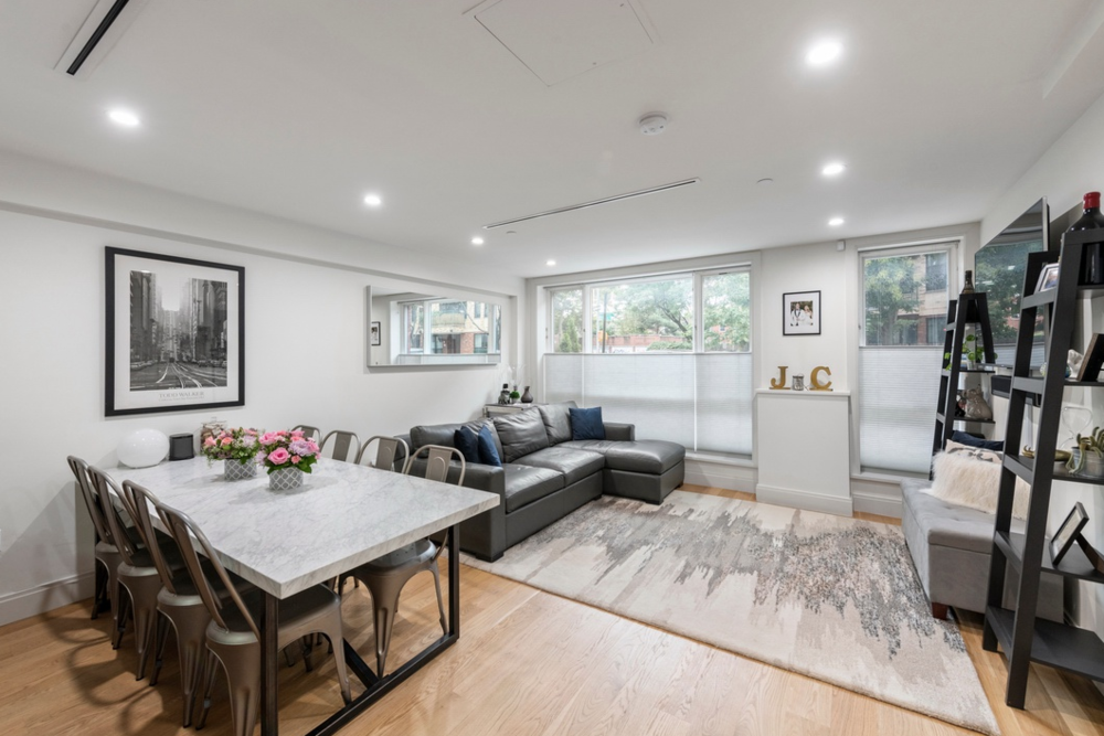 251 WITHERS STREET, 1A - $1,445,000 // 2 Beds // 2 Baths // 1,186 SQFTA bright Williamsburg condo graced with pristine finishes and a private backyard, this 2-bedroom, 2-bathroom home epitomizes contemporary Brooklyn living. Features of this 1,186 sq. ft. garden apartment include gorgeous hardwood floors, oversized Pella windows with northern and southern exposure, central heating and cooling, an in-unit washer/dryer, and a 1,026 sq. ft. backyard with a stone walkway, no-maintenance artificial turf, electrical and plumbing infrastructure, globe lighting, and an enclosed planting zone for trees, shrubs, flowers, and herbs.