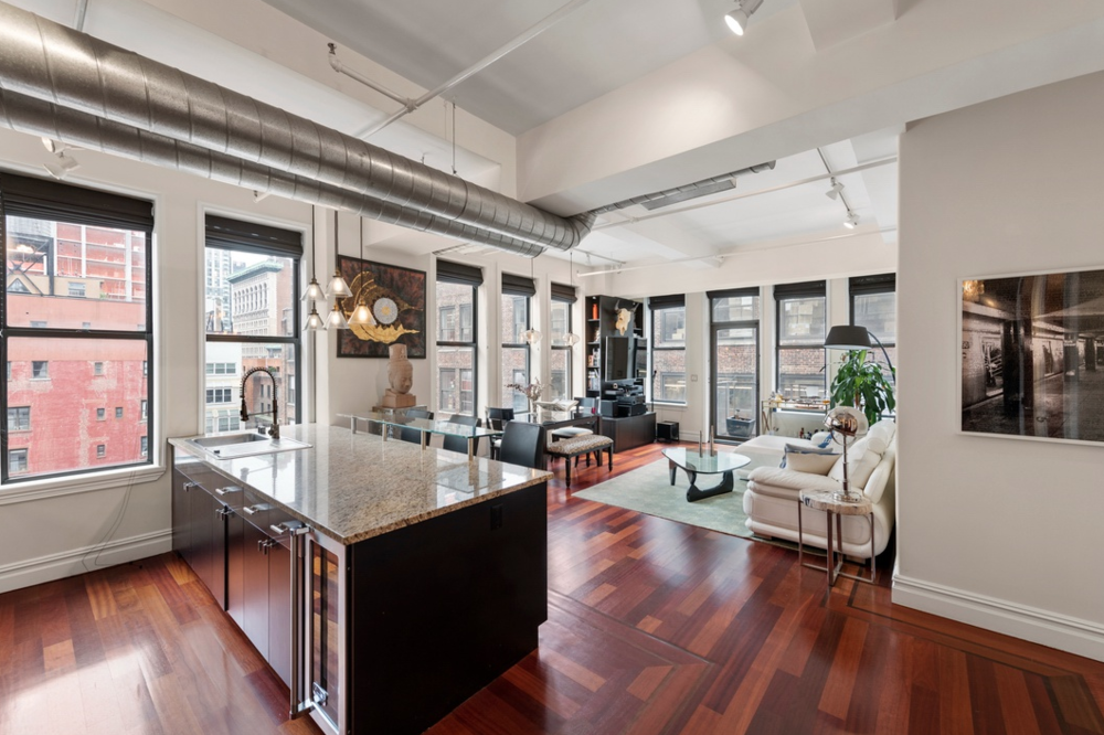 45 EAST 30TH STREET, 14C - $1,995,000 // 2 Beds // 2 Baths // 1,363 SQFT // 155 EXSFThis bright open concept home is an entertainer's dream with airy 11'' ceilings, oversized picture windows, Brazilian cherry hardwood floors, plenty of closet space, and a washer and dryer. Enjoy cooking in your open chef's kitchen with Giallo Granite counters, bar seating, and top of the line appliances including a LG refrigerator, Kitchenaid dishwasher, Viking range, oven, and 24 bottle wine cooler.