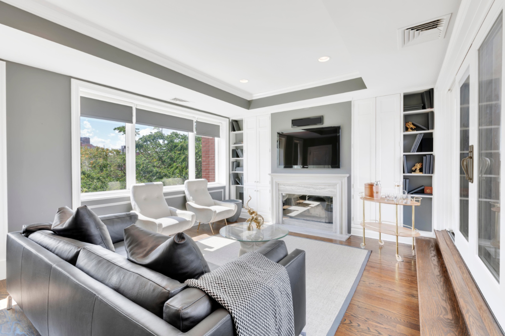 1 LEROY STREET, PH5C - $6,995,000 // 3 Beds // 3.5 Baths // 2,895 SQFT // 479 EXSFEnter into this extraordinary residence to an impressive view of the grand staircase which is topped with a gorgeous skylight. As you continue into the home, your eye is then drawn to an inviting living room filled with natural light and charming architectural details. The handsome wood burning fireplace has an exceptional mantle made of reclaimed wood from the Plaza Hotel and single slab marble surround. Opposite the living area is a fully renovated chef's kitchen outfitted with top name brand appliances including Sub-Zero, Bosch, & a gas stove by Viking.