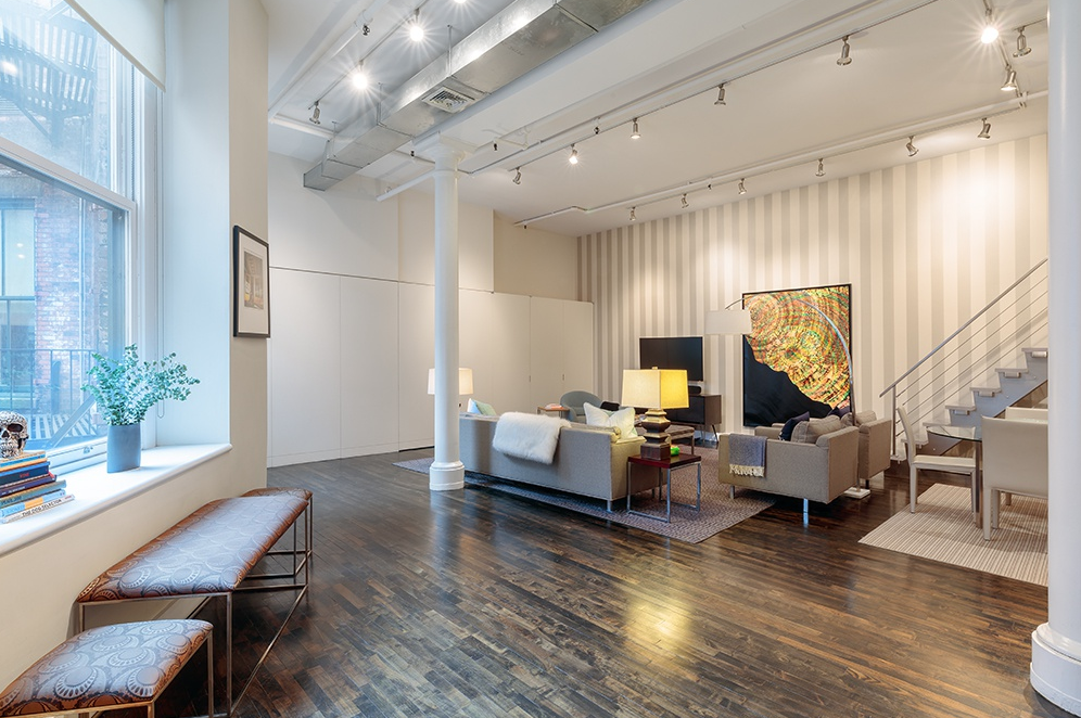 514 BROADWAY, 5G - $1,950,000 // 1 Bed // 1 Bath // 1,720 SQFTBoasting an array of deluxe finishes and a thoughtful open plan layout, this 1-bedroom, 1-bathroom SoHo co-op is a seamless blend of contemporary luxury and industrial charm. Features of this pin-drop quiet 1,720 sq. ft. apartment include gorgeous hardwood floors, airy 13-ft ceilings, exposed pipes and ducts, central heating and cooling, northern exposure, a roomy loft space, and convenient in-unit washer/dryer.
