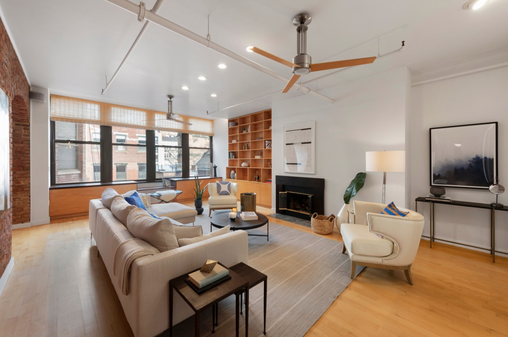 345 WEST 13TH STREET, 5A - $4,250,000 // 3 Beds // 2.5 Baths // 2,400 SQFTAn immense, 2,400 sq. ft. condo nestled in a prime West Village locale, this expansive 3-bedroom, 2.5-bathroom loft is a seamless blend of contemporary elegance and industrial charm. It is just steps from the High Line, Chelsea Market, and Hudson Street, and it features a number of incredibly chic fixtures and finishes. These include airy 10-ft ceilings, hardwood floors, a wood-burning fireplace, an in-unit washer/dryer, custom built-ins, large windows with northern, eastern, and western exposure, and a series of character details including exposed pipes, wooden beams, and stunning redbrick walls with built-in arches.