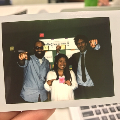 Playful image of all 3 team members of the Civic Innovation Office.