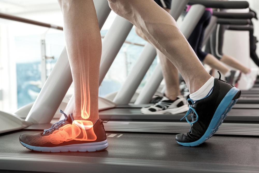 podiatrist serving marquette, escanaba, upper peninsula, michigan area prescribes custom orthotics for foot, hip, lower back, knee pain relief