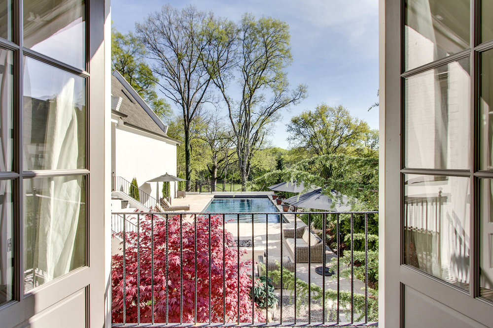 WOODMONT BLVD - With stunning architecture, a fresh neutral palette, and an outdoor oasis that can be savored from the home's dreamy Juliette balcony, this home is truly a sanctuary.