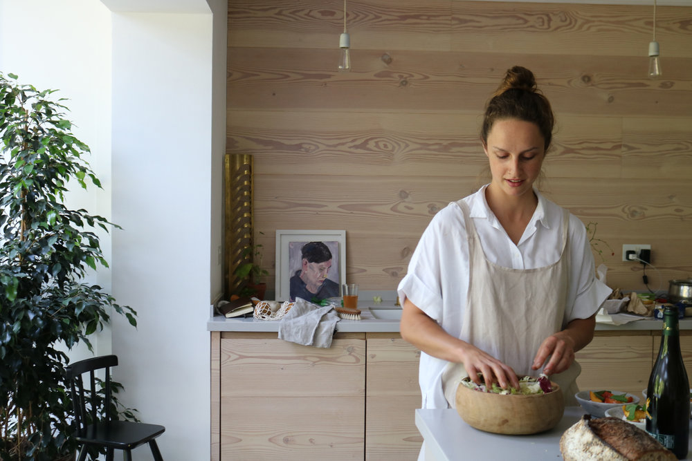 Brunette making salad in a wooden kitchen | London Lifestyle Photoshoot | Creative Direction
