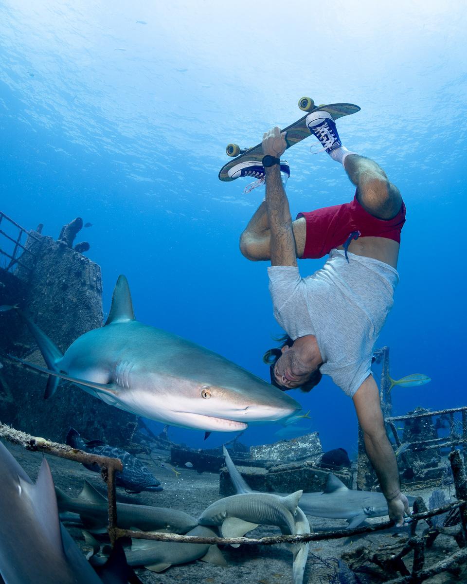 Skateboarder Underwater Model with Sharks