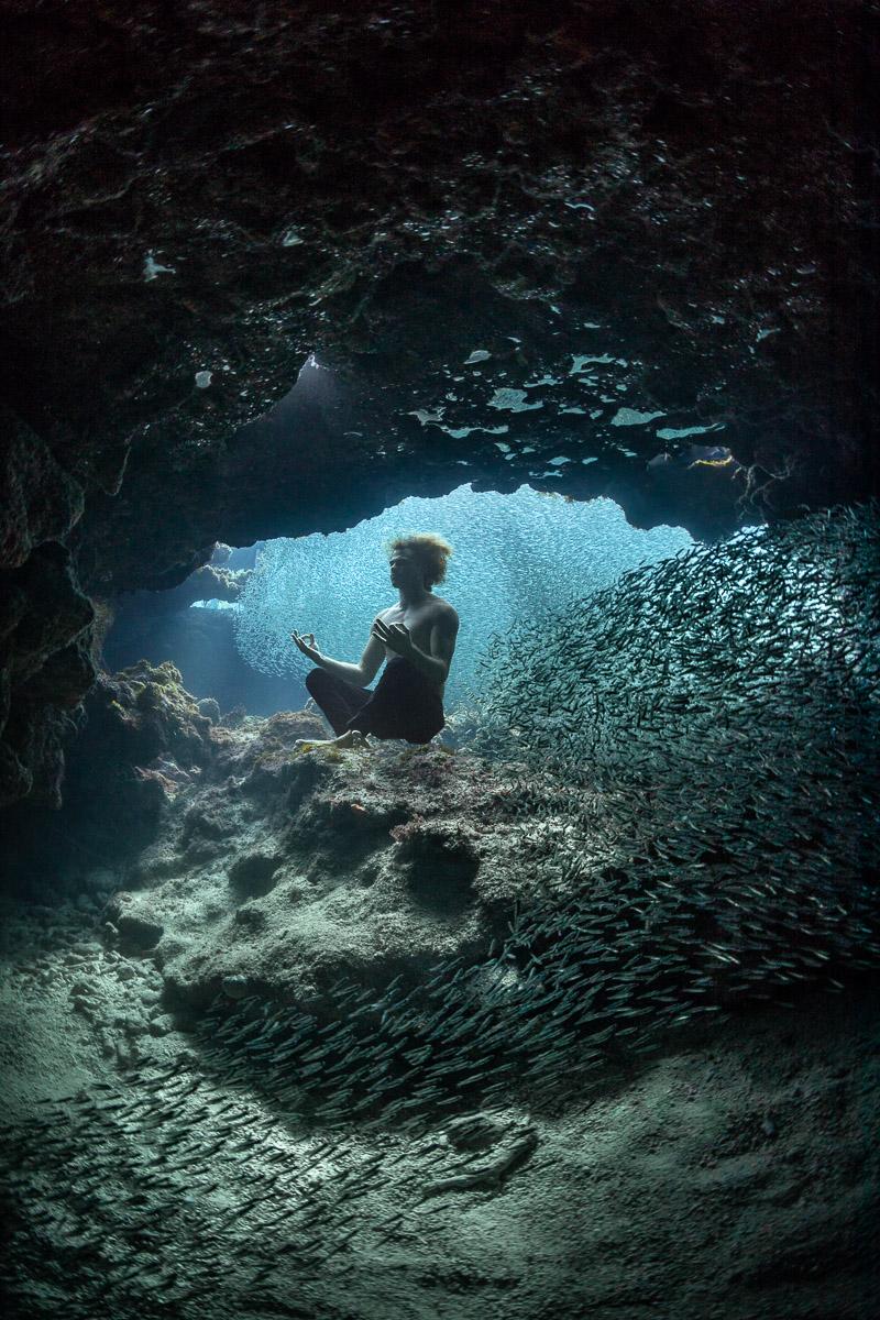 Freediver Meditiates in Underwater Cave