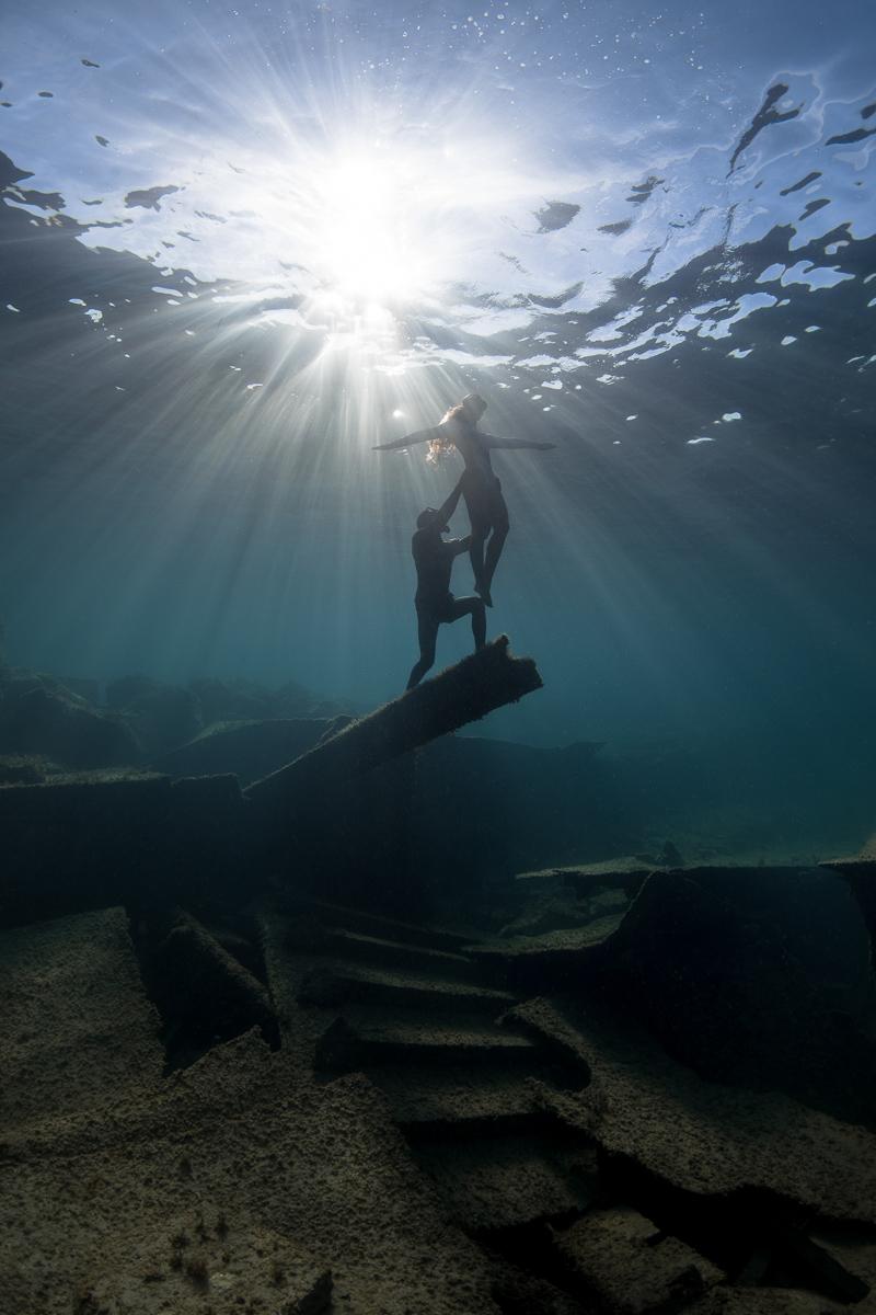 Underwater Sunburst with Freedivers