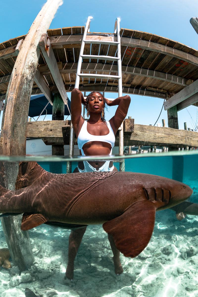 Tanyka Renne with Nurse sharks underwater Exuma Bahamas