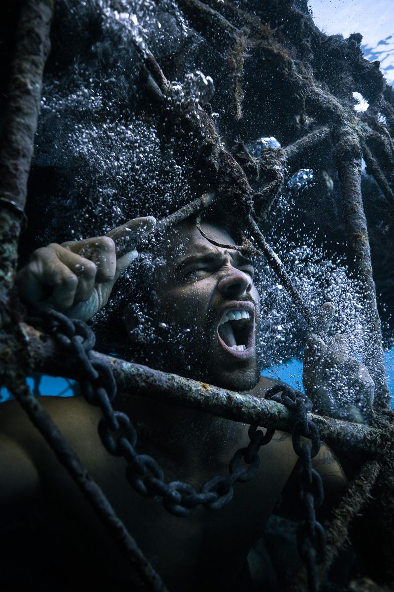 Caged underwater