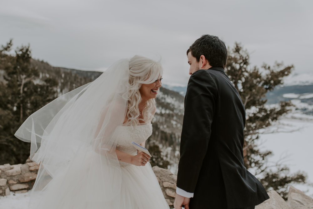 Ceremony at a Sapphire Point winter elopement in Dillon, Colorado. Colorado adventure elopement and wedding photographer.
