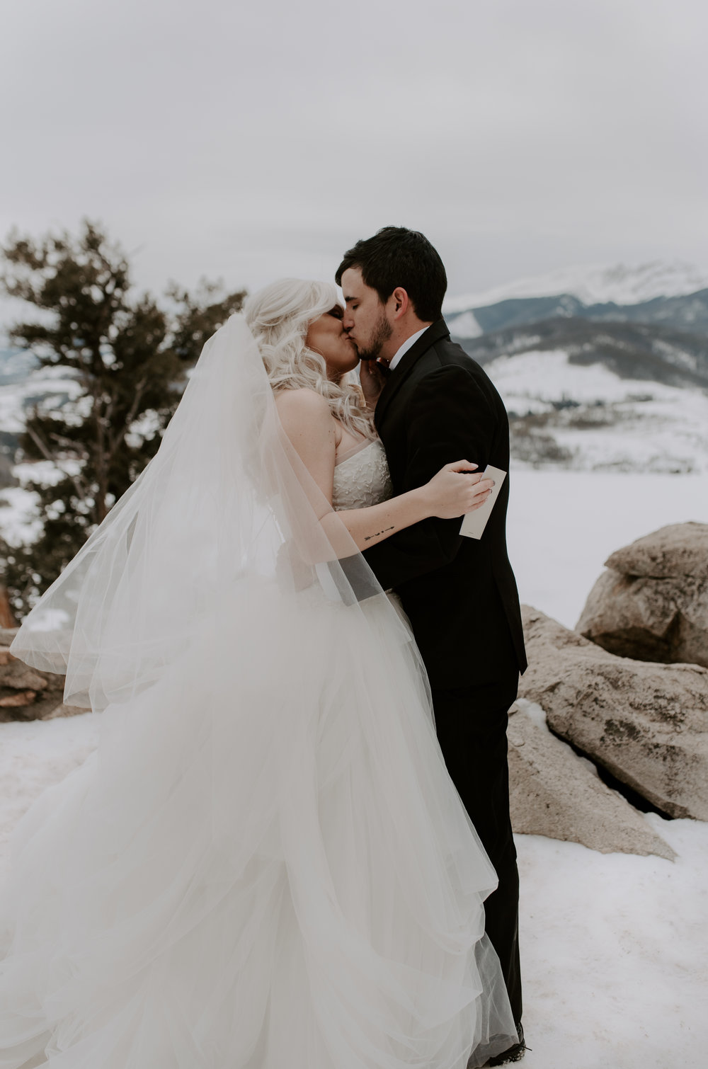 First kiss after the ceremony at this Sapphire Point elopement taken by a destination elopement and wedding photographer based in Colorado.