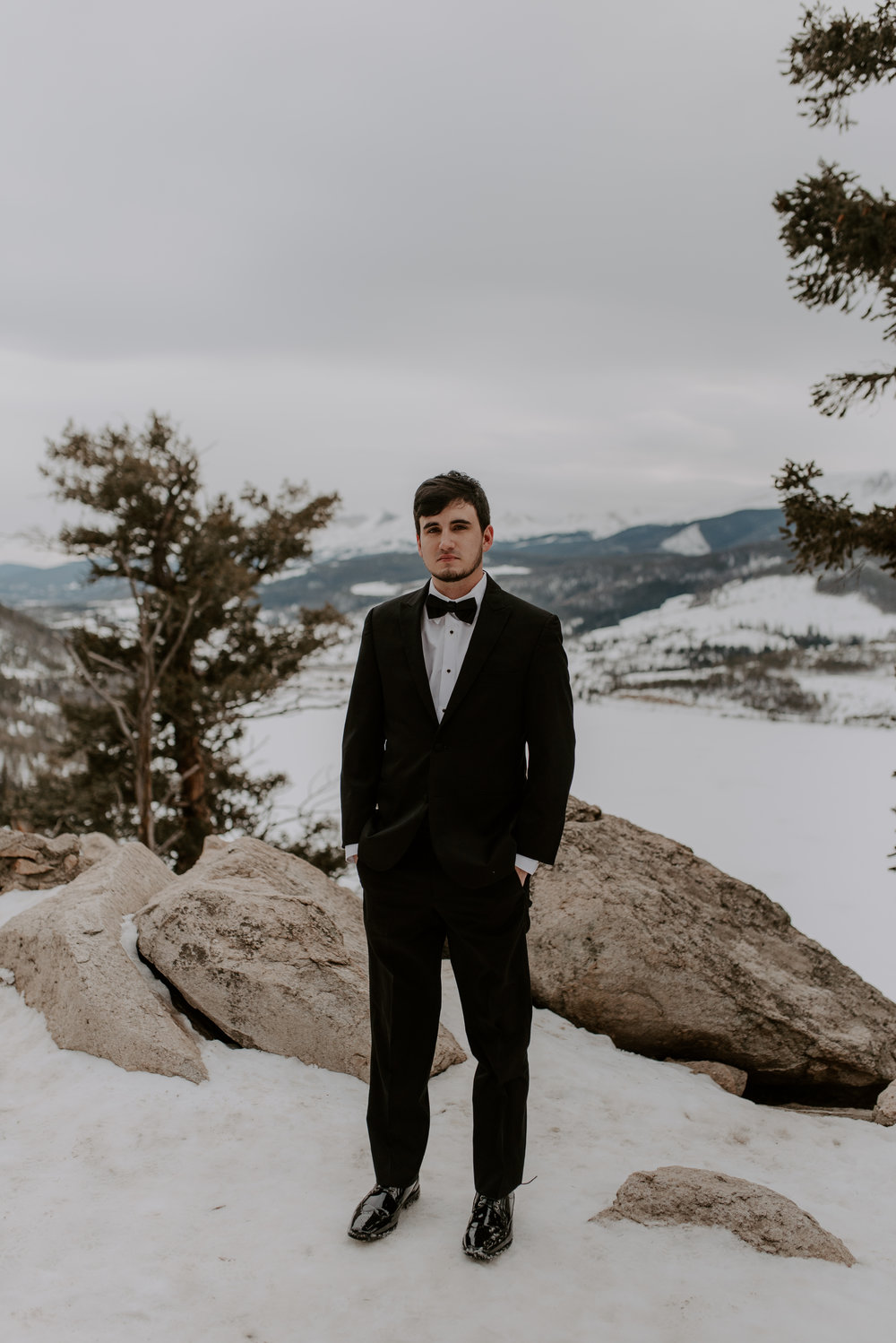 Groom portraits by a Colorado elopement photographer at a Sapphire Point winter elopement.