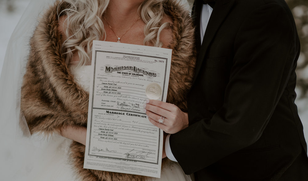 Winter wedding at Sapphire Point in Dillon, Colorado. Marriage license shot by a Colorado elopement photographer.