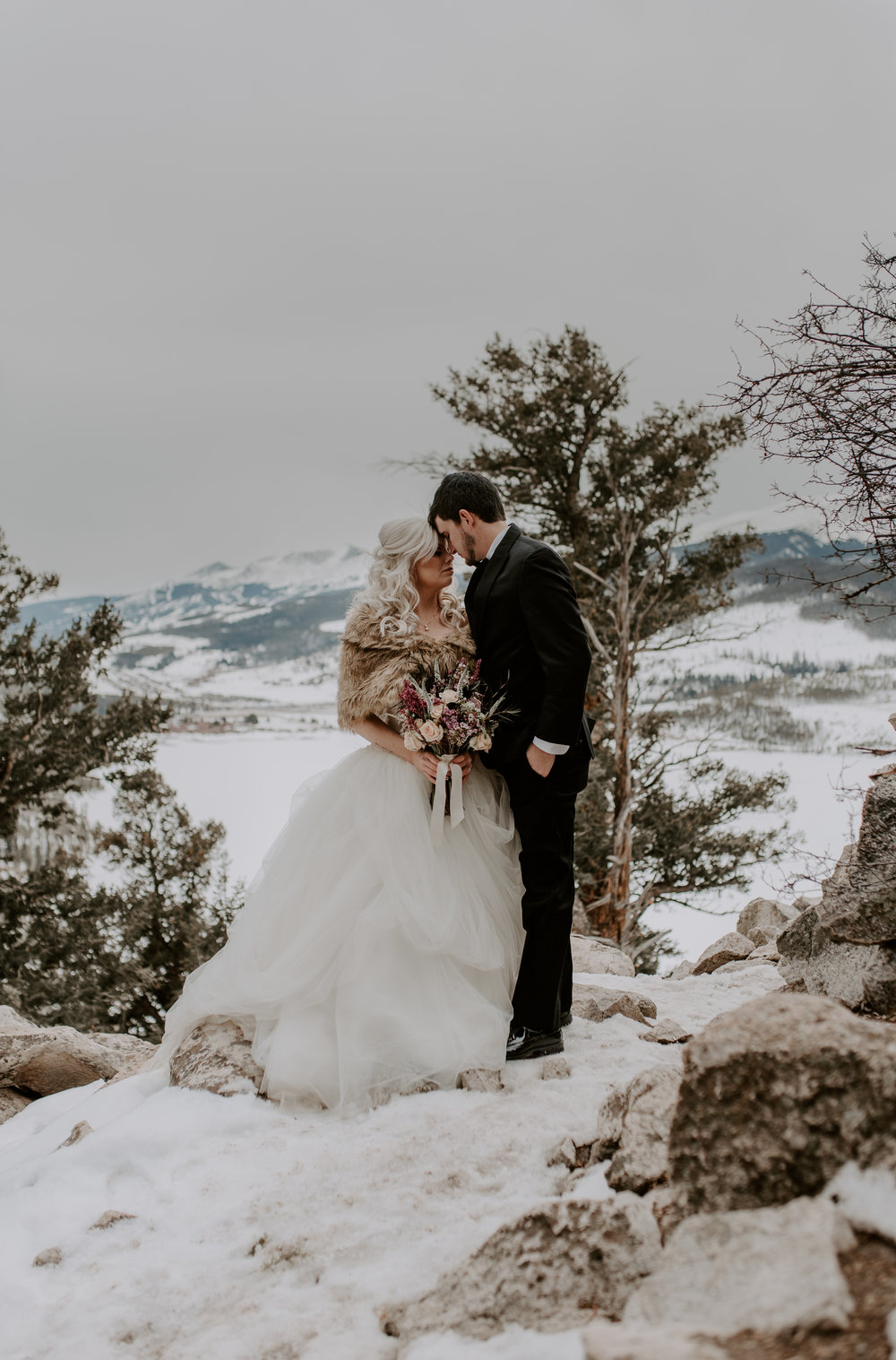 Winter elopement at Sapphire Point. Colorado wedding photographer.