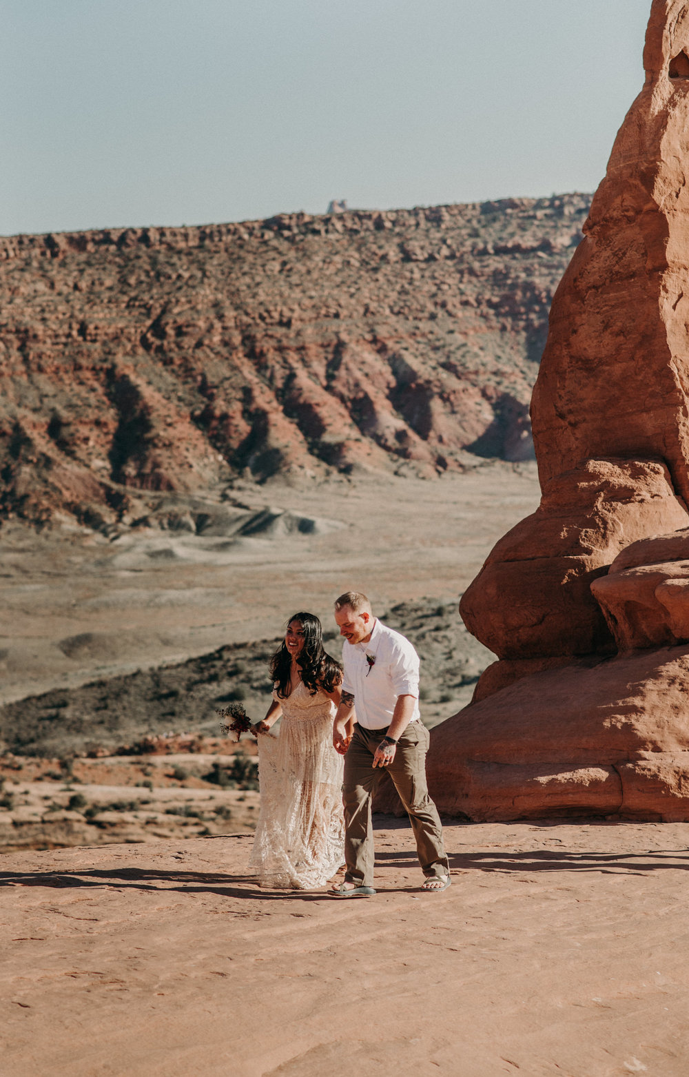 Adventure elopement at Arches National Park. Moab elopement photographer.