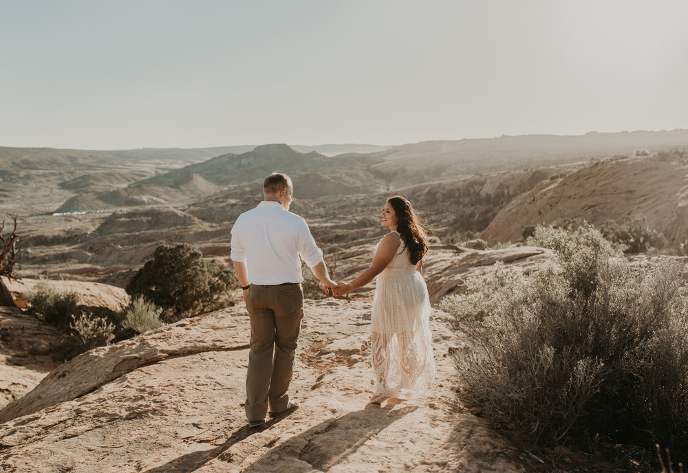 Delicate Arch elopement photos in Moab. Moab elopement photographer