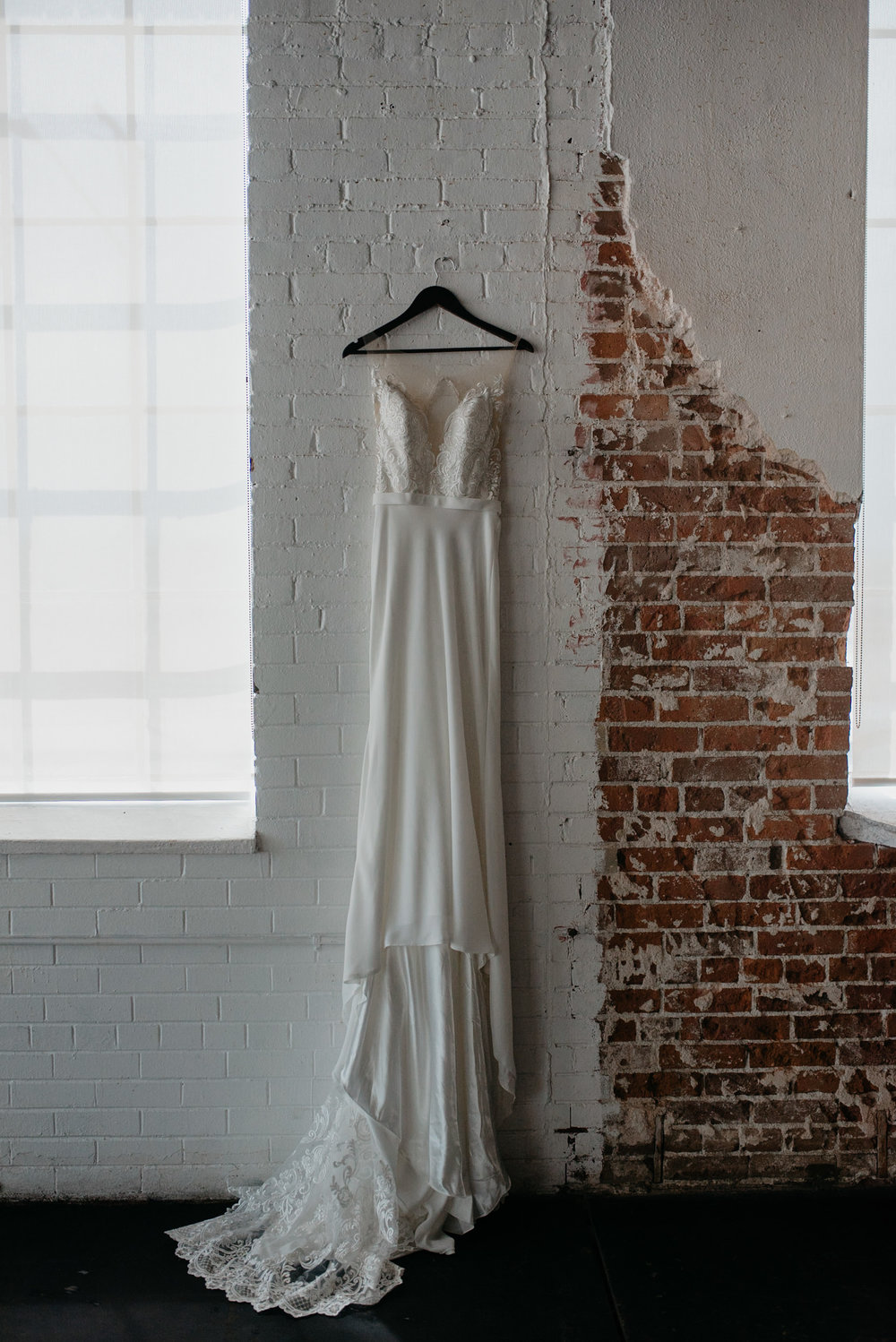Downtown Denver, Colorado wedding at Moss. Colorado wedding photographer. Photo of dress at Moss.