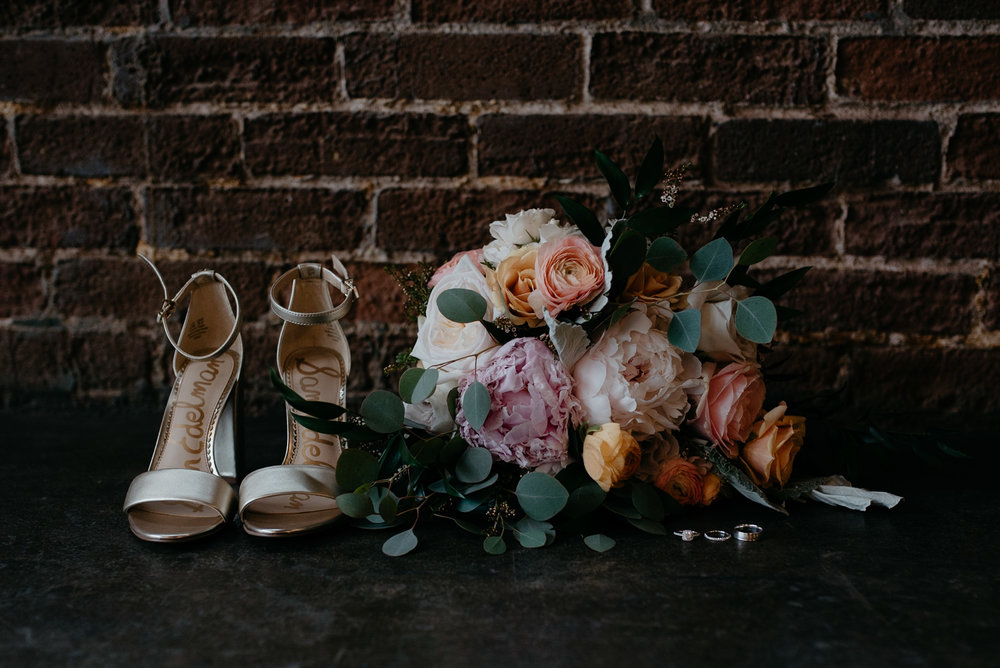 Denver, Colorado wedding at Moss. Colorado wedding photographer. Florals and shoes at Moss.