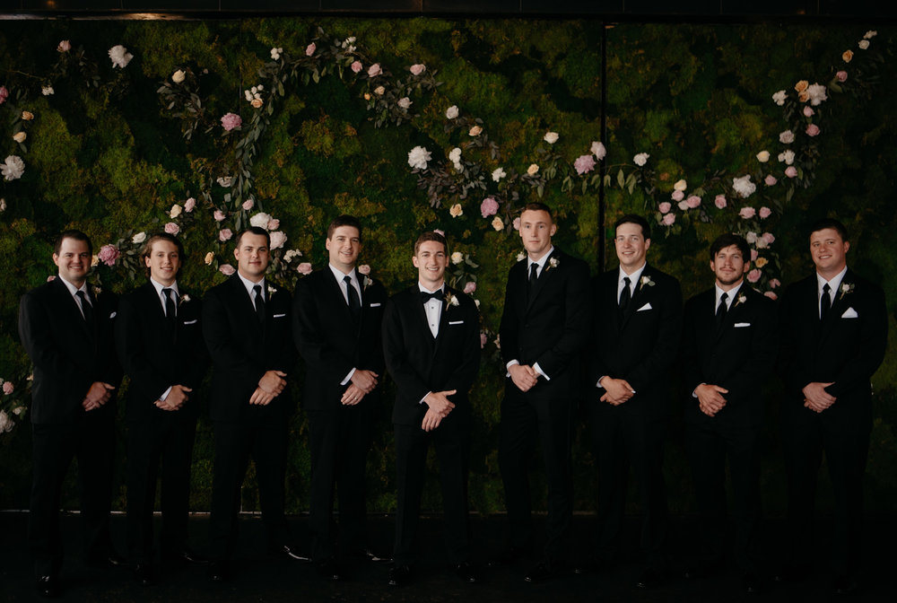 Groomsmen photos at a Colorado wedding at Moss in Denver. Denver wedding photographer.