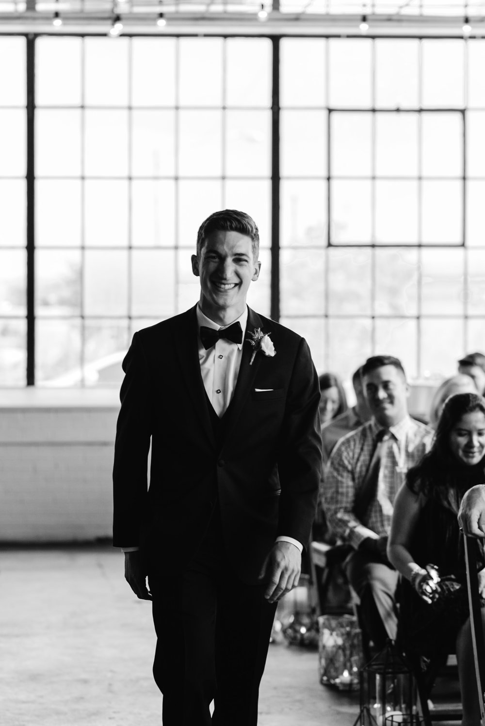 Groom walking down the isle at Moss Denver Wedding. Colorado wedding photographer.