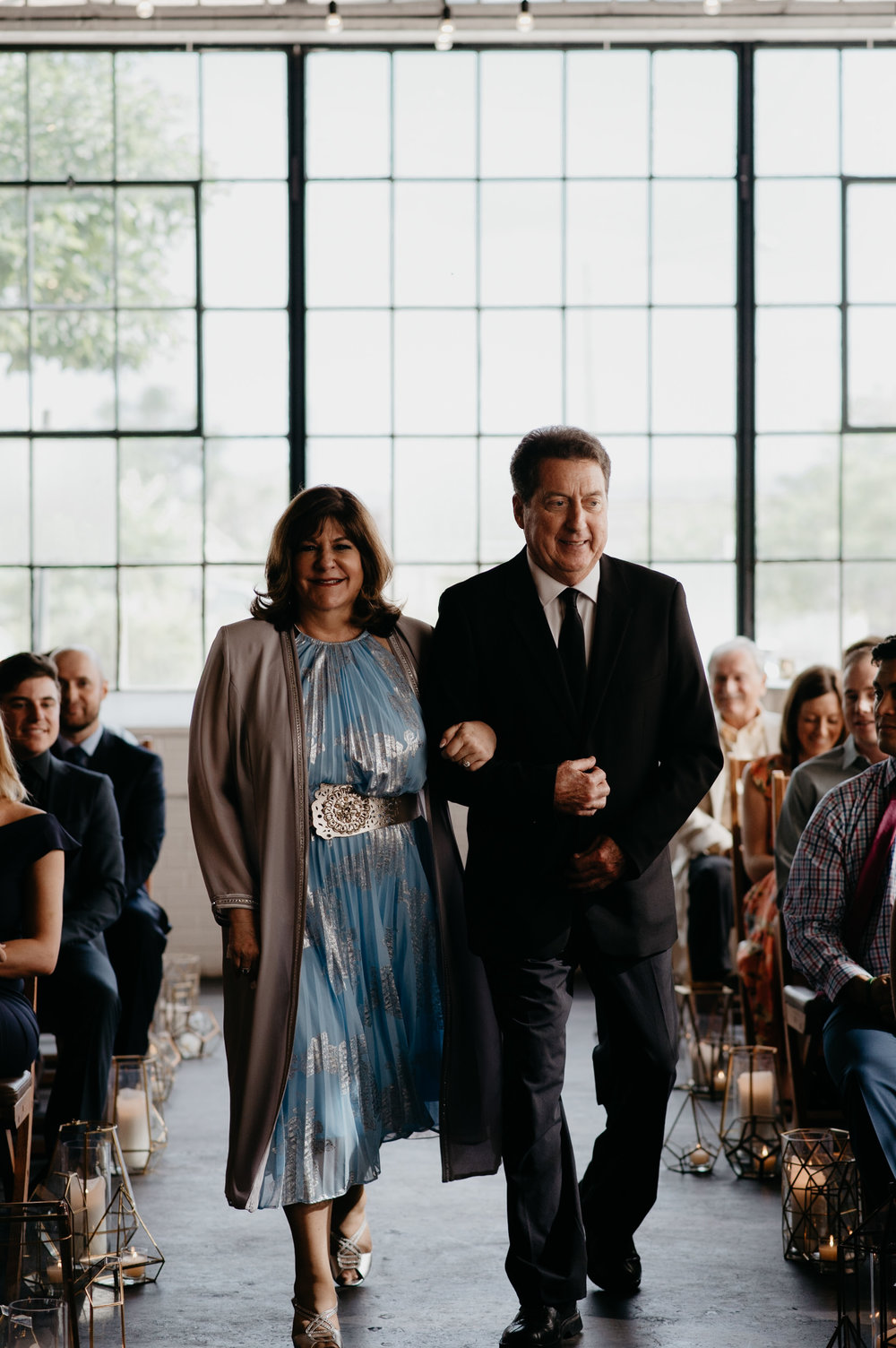 Mom and Dad walking down the isle at a Moss Denver wedding. Colorado wedding and elopement photographer.