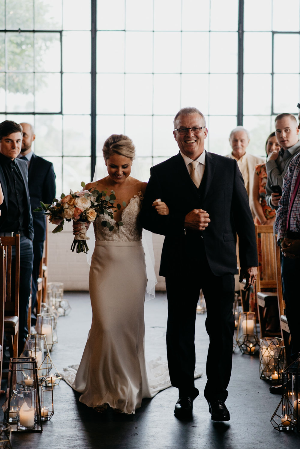 Bride and dad walking down the isle at Moss Denver wedding. Colorado wedding photographer.