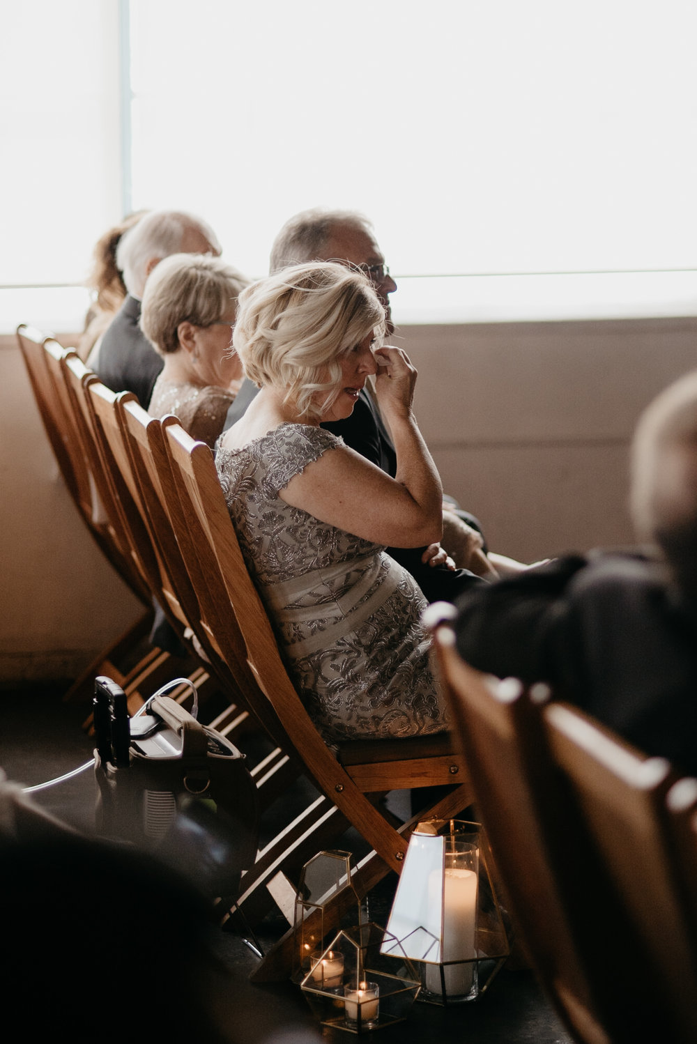 Mom crying at Denver Moss wedding ceremony. Colorado wedding photographer. Downtown Denver wedding venue.