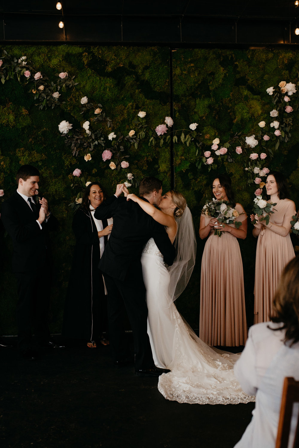 First kiss at Moss Denver wedding. Colorado wedding photographer.
