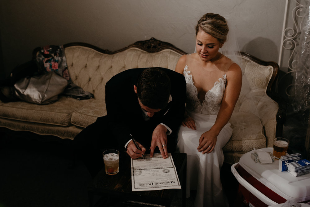 Signing marriage license at Moss in Denver. Colorado wedding photographer.