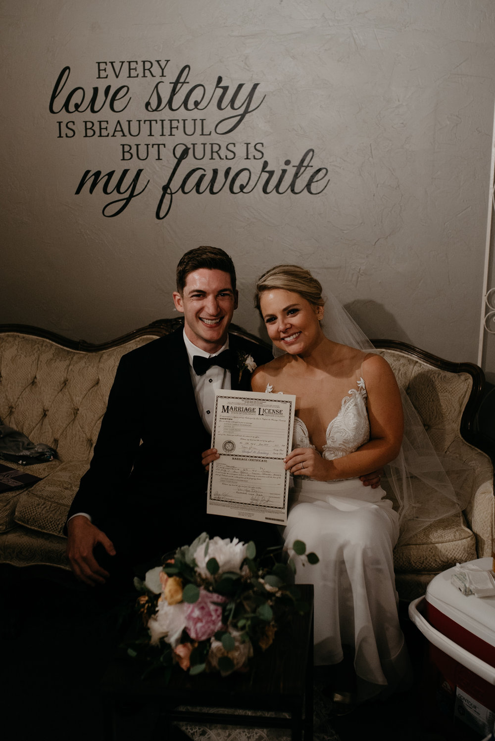 Bride and groom with marriage license. Moss Denver wedding photographer.