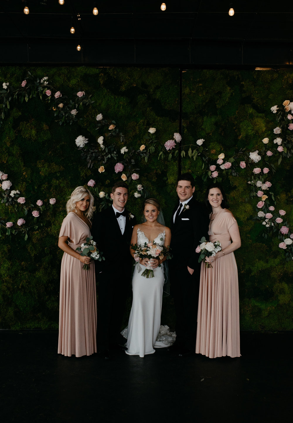 Bride and groom with siblings at Moss in Denver. Colorado wedding and elopement photographer.