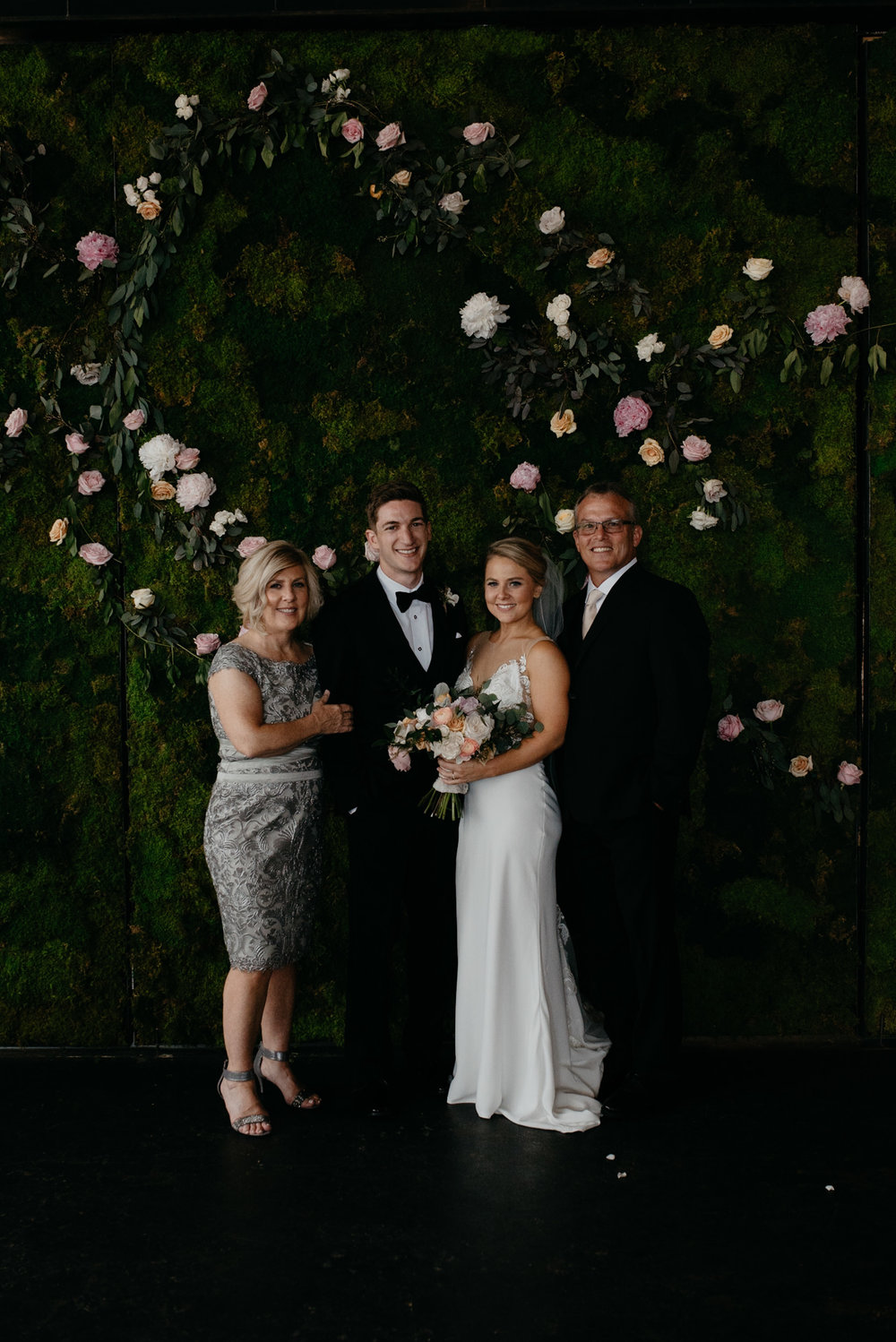 Bride with mom and dad at Moss in Denver. Colorado wedding photographer.