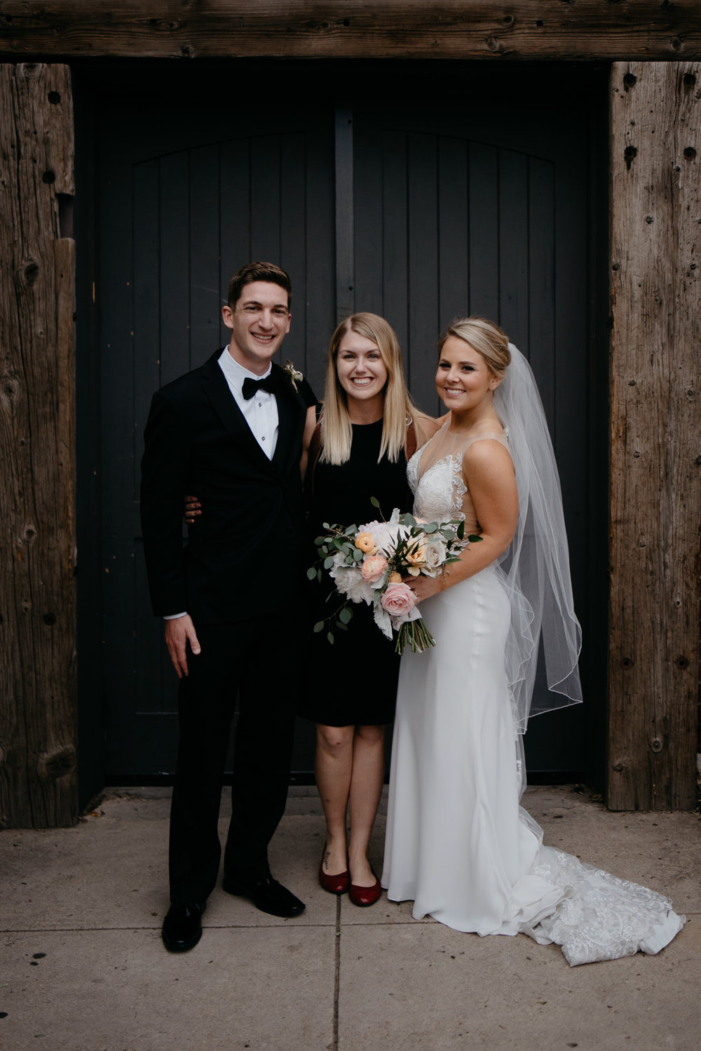 Photographer, Alyssa Reinhold with bride and groom at wedding at Moss in Downtown Denver.