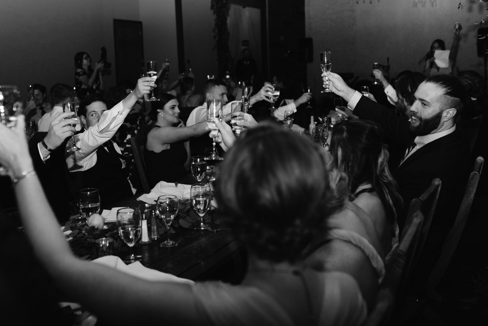 Toasts at Moss Denver wedding. Denver wedding photographer.