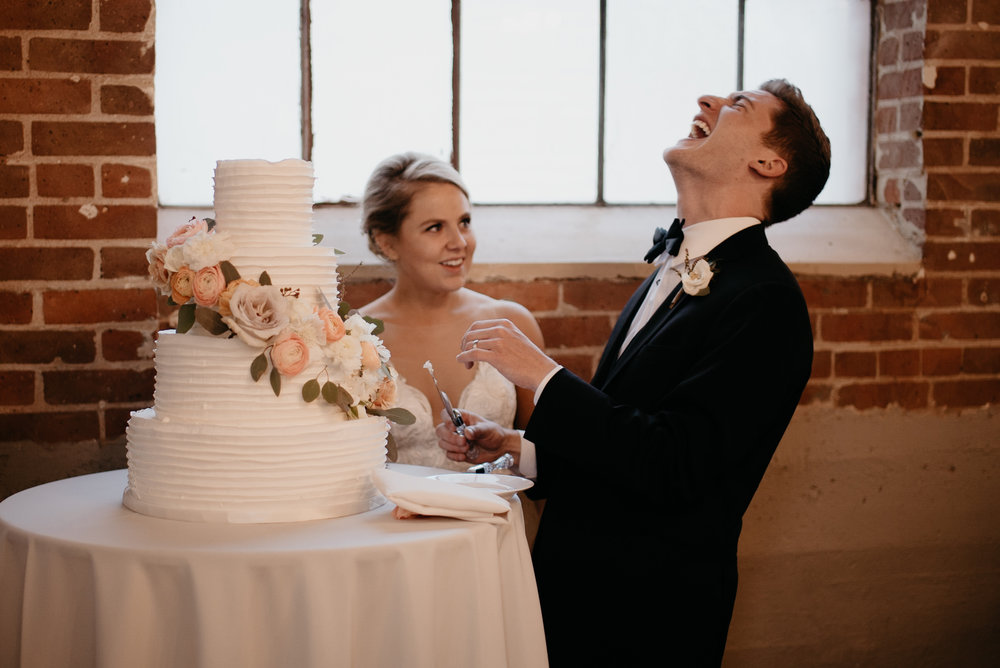 Denver wedding photographer. Cake cutting at Moss in Denver.