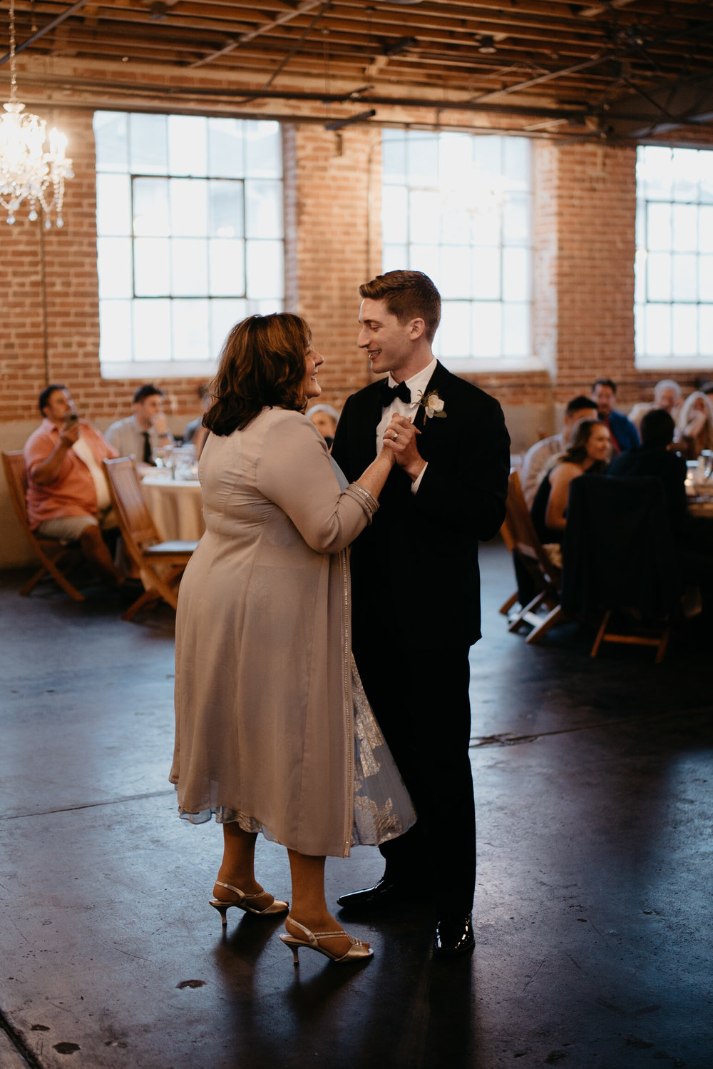 Denver city wedding at Moss. Mother and son dance. Colorado wedding photographer.