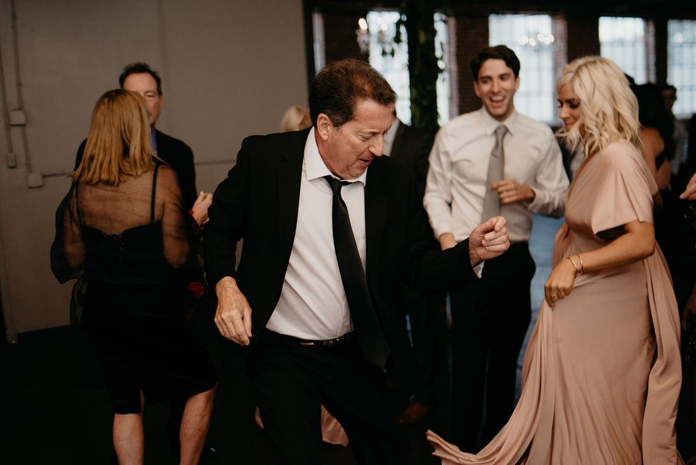 Dancing photos at Moss in Denver. Colorado wedding photographer. Downtown Denver wedding.