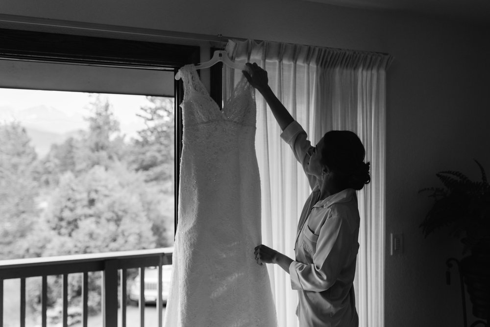 Bride getting dress. 3M Curve, Rocky Mountain National Park elopement.