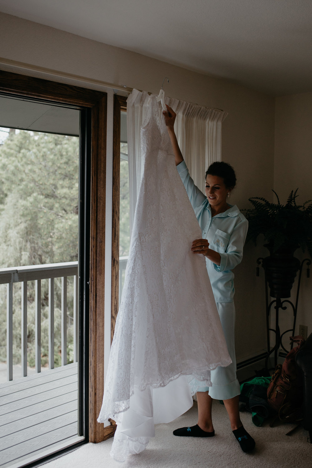 Bride getting dress on. 3M Curve, Rocky Mountain National Park elopement.