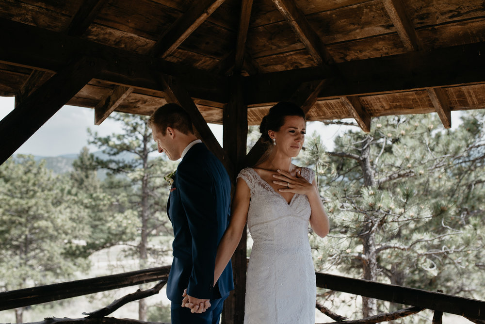 Bride and groom first look at Rocky Mountain National Park elopement. Colorado elopement photographer. 3M Curve wedding.