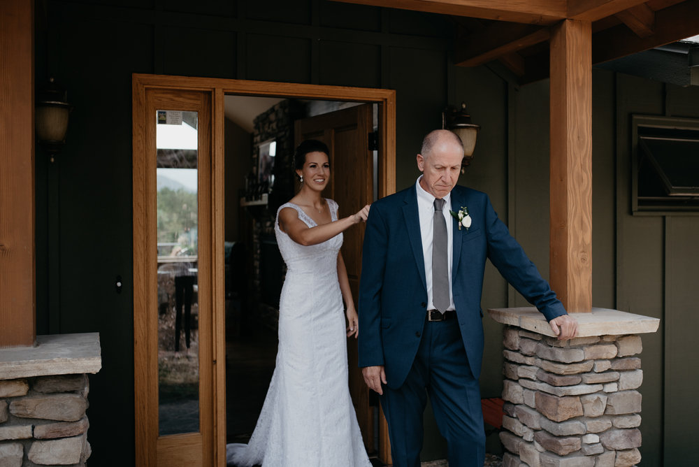 Father, daughter first look. Estes Park elopement. Colorado wedding photographer.