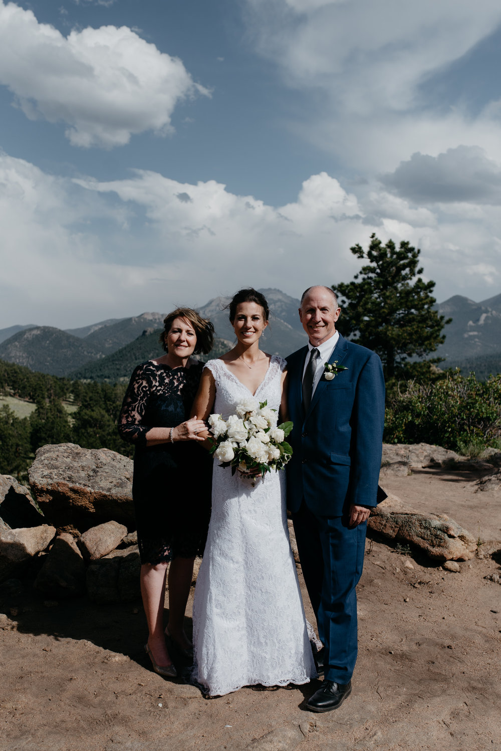 Family photos at Rocky Mountain National Park elopement. Wedding ceremony at 3M curve in Colorado.