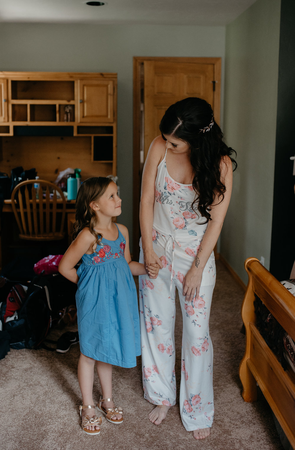 Bride and flower girl getting ready. Wedding at Sapphire Point. Colorado wedding photographer.